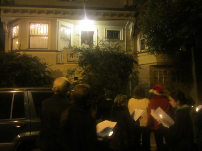 Carolers visit a house on Elsie Street.