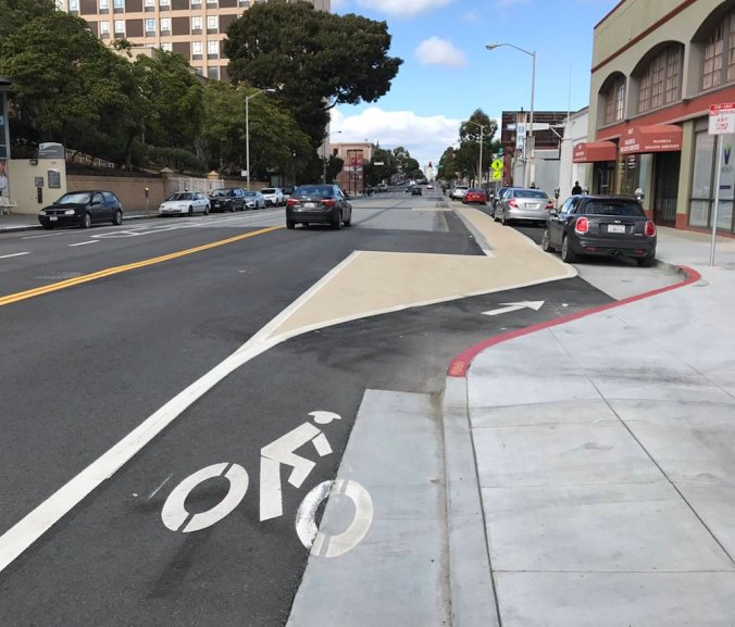 Cars parking in the new Valencia bike lane on Feb. 26. Photo via @roessler
